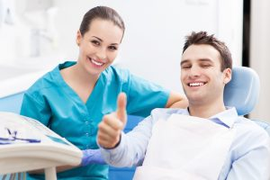 Man giving thumbs up at dentist office