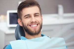 man smiling undergoing dental checkup