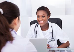woman seated consulting with dentist