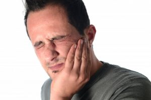 man with toothache needs to visit dentist in Harker Heights