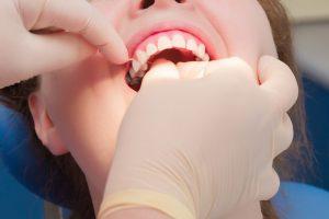 dentist in Harker Heights flossing teeth